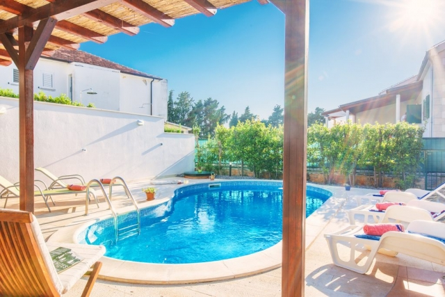 Private swimming pool with bed chairs in Villa Cvita