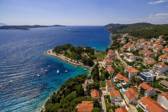 Drone view at Villa Cvita and attractive front bay of Hvar
